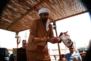 Ali al-Saloom, serving coffee to the guests on his pearl diving boat